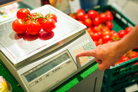Weighing Tomatoes Stock Photo