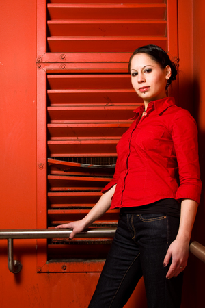 Young Woman In Front Of A Red Wall