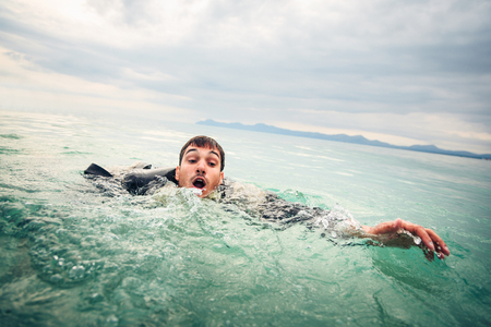 Businessman Drowning in the Sea