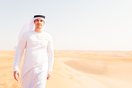 Young Arabian Man In The Desert Stock Photo