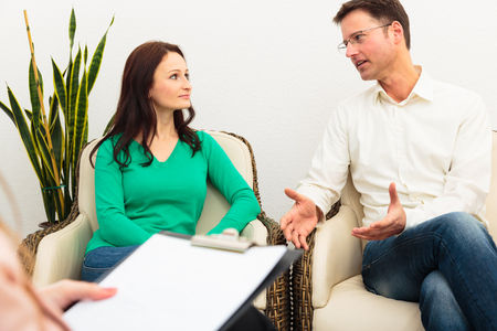 Couple Seeing A Psychotherapist Stock Photo