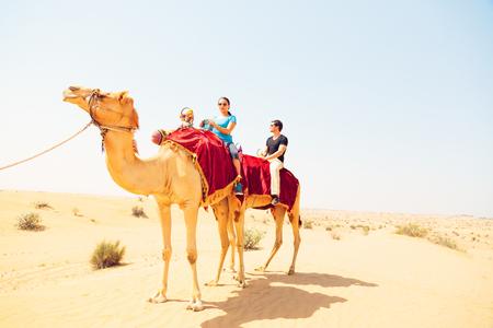 Tourists Riding Through The Desert Stok Fotoğraf