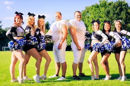 American Football Players And Cheerleaders