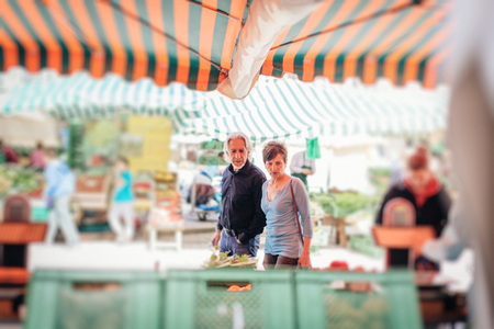 Senior Couple Visiting Farmers Market Stock Photo
