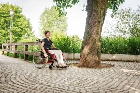 Senior People In Wheelchair Stock Photo