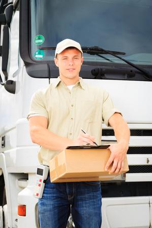 Delivery Boy Standing Next To His Van Stock fotó