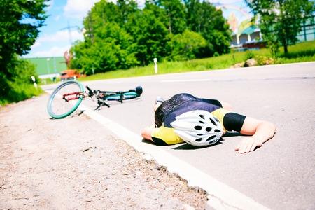 Cyclist Fallen From His Bike Zdjęcie Seryjne