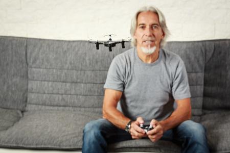 Senior Man Playing With A Drone Zdjęcie Seryjne