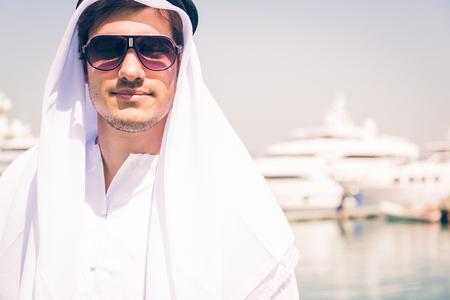 Young Arabian Man Next To A Yacht Port Zdjęcie Seryjne
