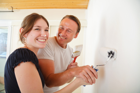 Young Couple Painting The Walls Stock Photo - 121737256