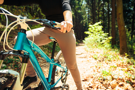 Young Woman Riding Her Mountain Bike 写真素材