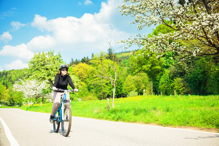 Young Woman Riding Her Mountain Bike Stock Photo - 121737309