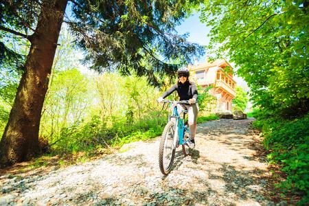 Young Woman Riding Her Mountain Bike Stock Photo