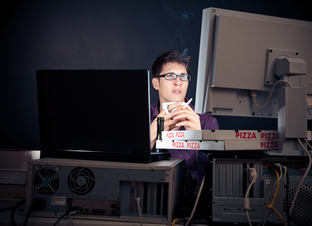 Young Man Spending His Night With Computers Stock Photo - 122140533