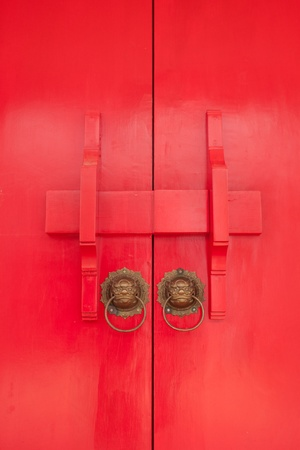 Red door in Thai temple Stock Photo