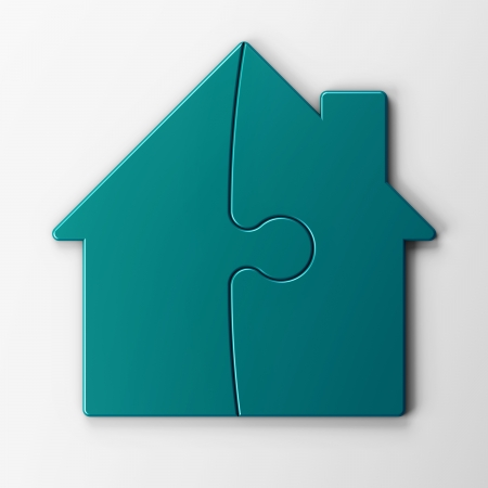puzzle of a house with clipping path photo