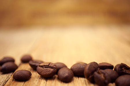 coffee with coffee beans and blur newspaper background