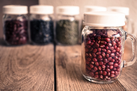 leguminous: beans in the glass bottle on the old wood table