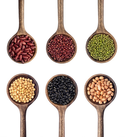 black beans: collection of beans in the wooden spoon Stock Photo