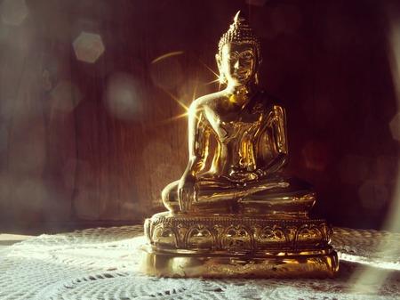 Golden Buddha Statue and sun light