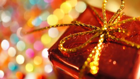 gold gift box: Presents on colorful bokeh background Stock Photo