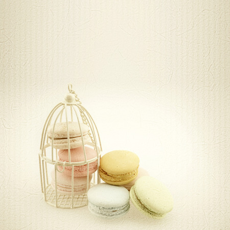 paper craft: macaroons in vintage color style on mulberry paper texture Foto de archivo