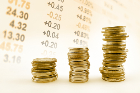 stock prices: rows of coins on display of Stock market