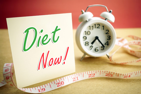 reminding: alarm and Measuring tape diet concept