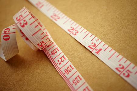 reminding: Measuring tape on craft paper for background diet concept