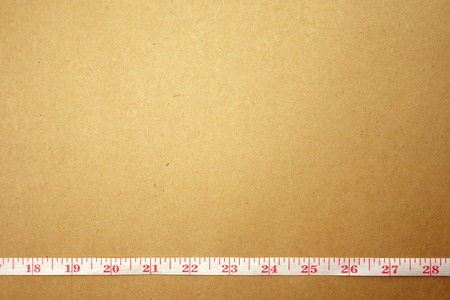 cintas metricas: Measuring tape on craft paper for background diet concept