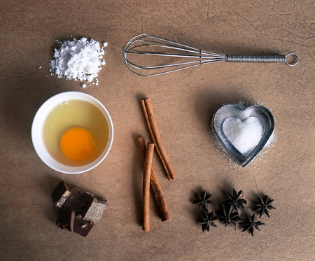 chocolate cakes: baking ingredients on old brown paper background