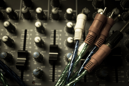 equalize: Audio equalizer control panel and cable