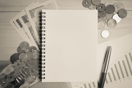 yen note: blank space note book , yen notes and asian coins for money concept background Stock Photo