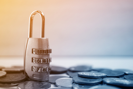 financial security: combination padlock on coin money for financial security concept