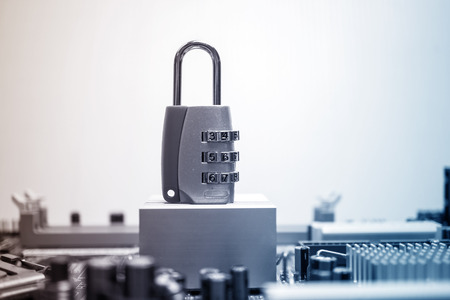 data processor: combination padlock on motherboard computer for security concept