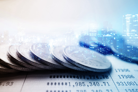 contabilidad financiera cuentas: Double exposure of city and rows of coins for finance and banking concept