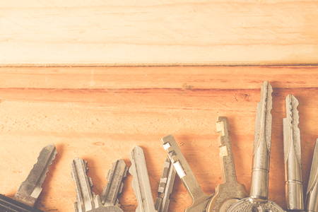 tresspass: Bunch of keys on a wooden table