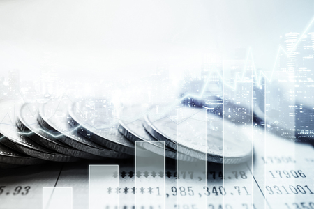 banking concept: Double exposure of graph and rows of coins for finance and banking concept