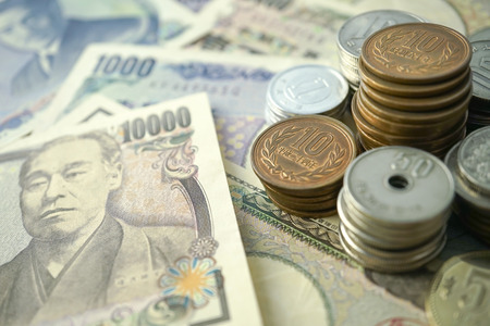 showa: yen notes and yen coins for money concept background