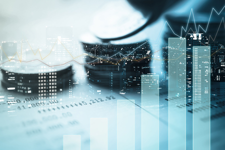 Double exposure of city, graph and rows of coins for finance and banking concept Standard-Bild