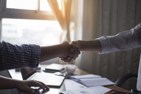 dealings: Business handshake and business dealings Stock Photo