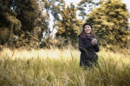 Beautiful girl walking in a meadow. Winter