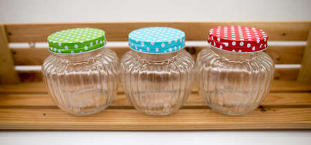 market place: Place jars on a shelf made of wood. Stock Photo