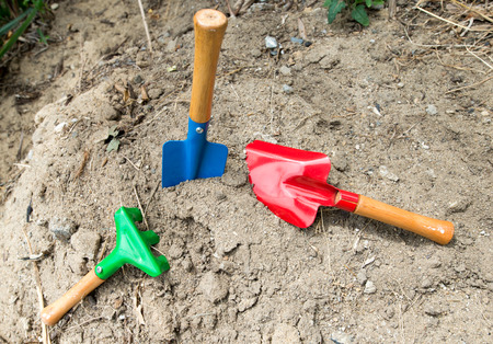 shove: Spade shovel embroidery on the ground. Stock Photo