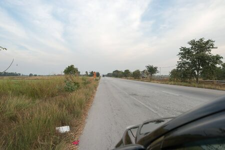 Car on country road background. Banco de Imagens