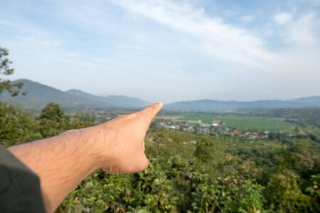 Pointing to the mountain