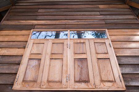 Two wooden window shutters