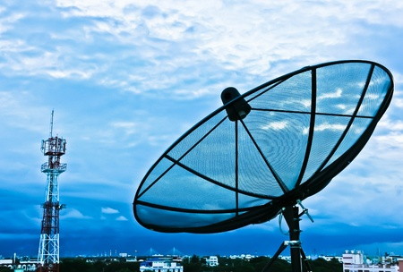 satellite tv: Satellite dishes in the evening for the city