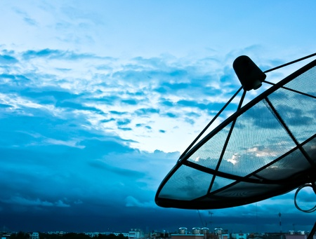 telecommunication equipment: Satellite dish to the sky in the evening
