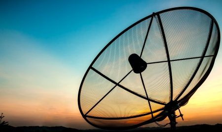 dish disk: satellite dish in the evening Stock Photo